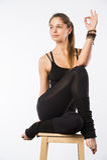 Sporty beautiful young woman sitting in Gomukhasana, Cowface pose, yin yoga Shoelace posture, asana for stretching hips Stock Images