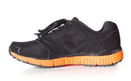 Sporty black sneakers Stock Images