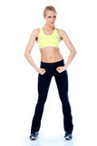 Sporty blond girl showing her muscles Royalty Free Stock Images