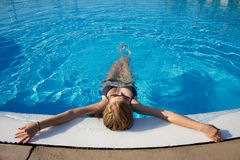 Sporty blond girl at the swimming pool Stock Image