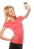 Sporty blond woman making selfie Stock Image
