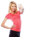 Sporty blond woman making selfie Stock Images