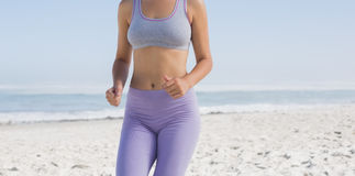Sporty blonde on the beach jogging Stock Image