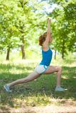 Sporty blonde girl doing fitness outdoor Royalty Free Stock Photo