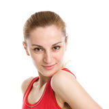 A sporty blonde in red leotard Royalty Free Stock Image