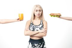 Sporty blonde refuses fast food stock photo