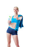 Sporty blonde woman after fitness workout showing thumb up and holding a water bottle stock images