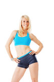 Sporty blonde woman smiling straight to the camera Stock Photography