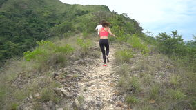 Sporty boy and girl jogging on mountain track. Woman and man work out in nature stock video footage