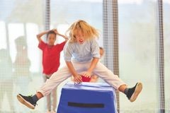 Sporty boy on the jump over a box. Sporty boy jumping over a box in a competition stock photos