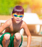 Sporty boy jumping into the pool Stock Images