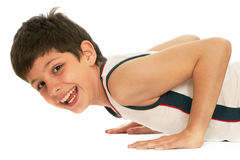 Sporty boy pushing up Stock Images