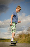 Sporty boy riding on the road waveborde Royalty Free Stock Photography