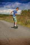 Sporty boy riding on the road waveborde Royalty Free Stock Images