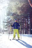 Sporty boy skiing in the forest. Sunny clear winter day Stock Images