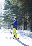 Sporty boy skiing in the forest Royalty Free Stock Photography