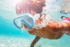 Sporty boy swimming underwater with scuba mask. Close-up portrait of sporty boy swimming underwater with scuba mask royalty free stock photo