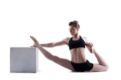 Sporty brunette doing stretching in studio Stock Photo