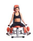 Sporty brunette on modern exerciser Stock Images