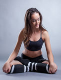 Sporty brunette posing in lotus position, close-up Royalty Free Stock Photography