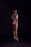 Sporty brunette with rope posing back to camera Royalty Free Stock Image