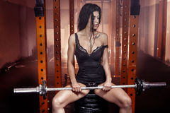 Sporty brunette woman in gym. Stock Image