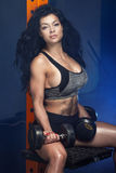Sporty brunette woman in gym. Royalty Free Stock Photos