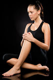 Sporty brunette woman relaxing while doing yoga Stock Images