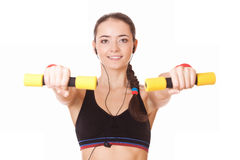 Sporty caucasian woman lifting dumbbells Stock Photography