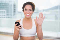 Sporty cheerful brunette waving Stock Photography