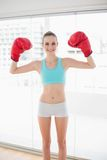 Sporty cheerful woman holding up boxing gloves Royalty Free Stock Photo