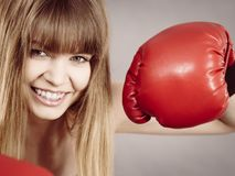 Cheerful woman wearing boxing gloves Royalty Free Stock Image