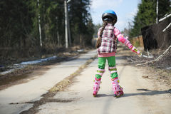 Sporty child girl on roller skates Stock Images