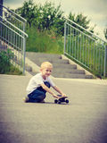 Sporty child kid with his skateboard outdoor. Royalty Free Stock Photos