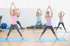 Sporty class doing pilate exercises in fitness studio Stock Images