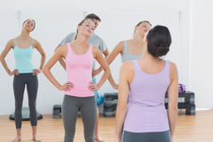 Sporty class doing pilate exercises in fitness studio Royalty Free Stock Image