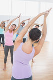 Sporty class with joined hands in fitness studio Stock Images