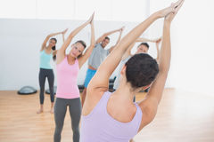Sporty class with joined hands in fitness studio Royalty Free Stock Images