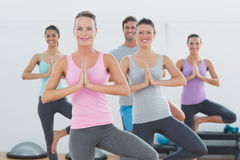 Sporty class with joined hands in fitness studio Stock Photos