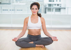 Sporty content brunette sitting in lotus pose Royalty Free Stock Image