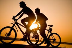 Sporty couple on bicycles Royalty Free Stock Image