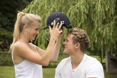 Sporty couple with cricket helmet Stock Image