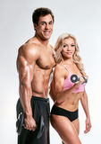 Sporty couple with dumbbells Stock Images