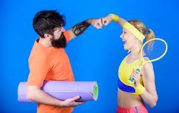 Sporty couple. Healthy lifestyle concept. Man and woman couple in love with yoga mat and sport equipment. Fitness royalty free stock photography