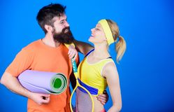 Sporty couple. Healthy lifestyle concept. Man and woman couple in love with yoga mat and sport equipment. Fitness royalty free stock photos