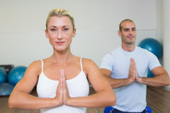 Sporty couple with joined hands at fitness studio Royalty Free Stock Image