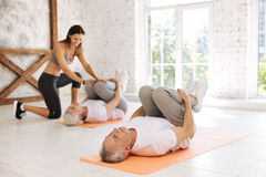 Sporty couple of mature people visiting fitness lessons Stock Photography