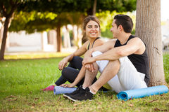 Sporty couple relaxing at a park Stock Photo
