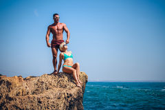 Sporty couple on the seashore. Stock Image