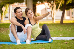 Sporty couple taking a selfie Stock Photography